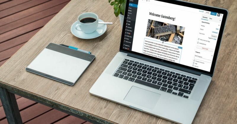 computer on table showing WordPress Gutenberg block editor