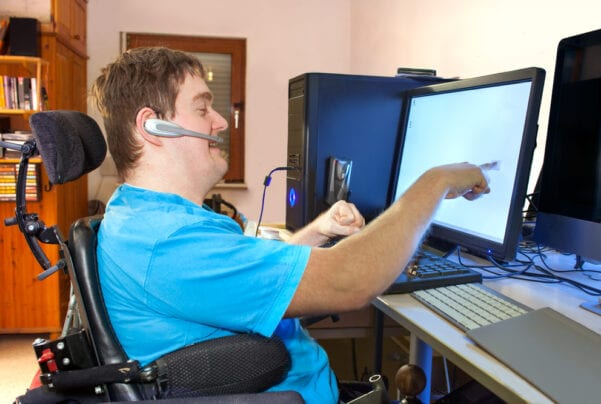 man with cerebral palsy using touch screen computer