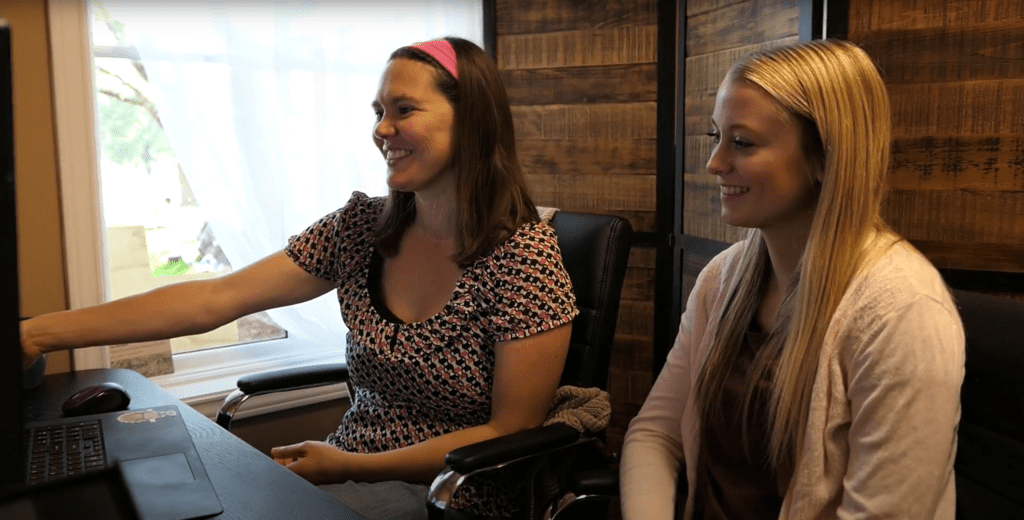amber and emma on a zoom call at the office