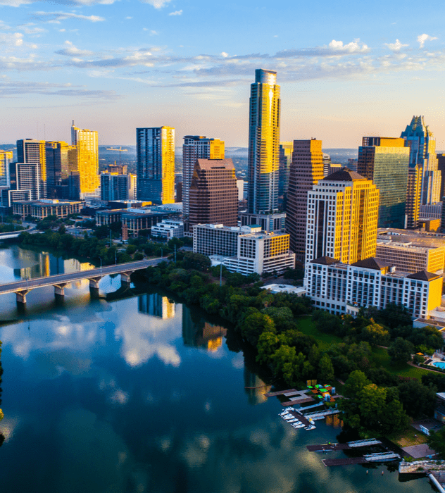 Austin, Texas skyline on bright day looking down at buildings and river