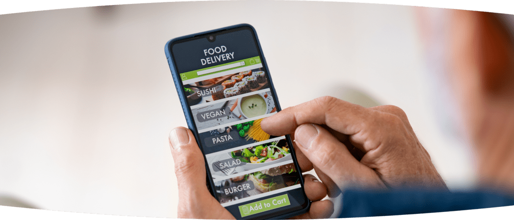 Close up of elderly man's hands holding a smart phone with a food delivery app on it showing a variety of food category options