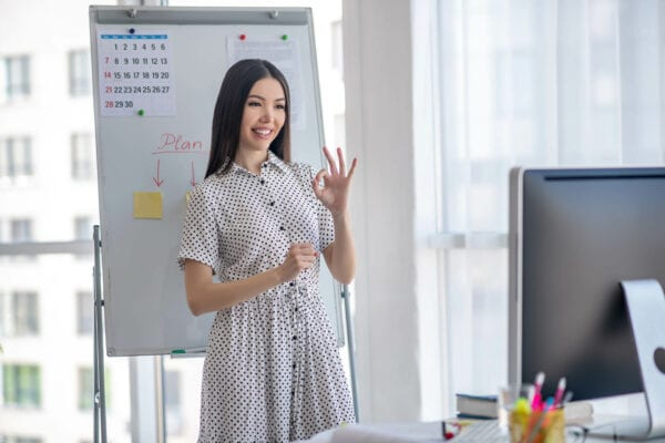 young woman making business presentation with sign language