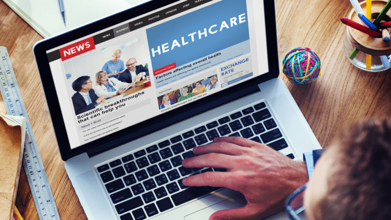healthcare website on a laptop with news section